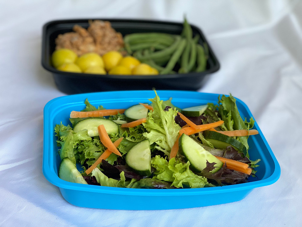 Our reusable container containing salad and main meal
