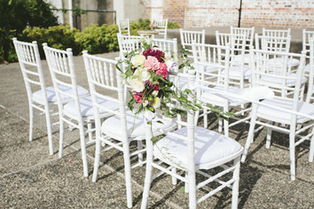 White-tiffany-chairs-with-flowers.jpg