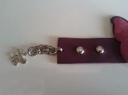 bracciale in pelle toni del viola con borchie semisferiche