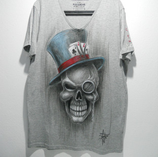 Poker and skull with top hat