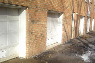 Low-lying garage doors with flood vents.