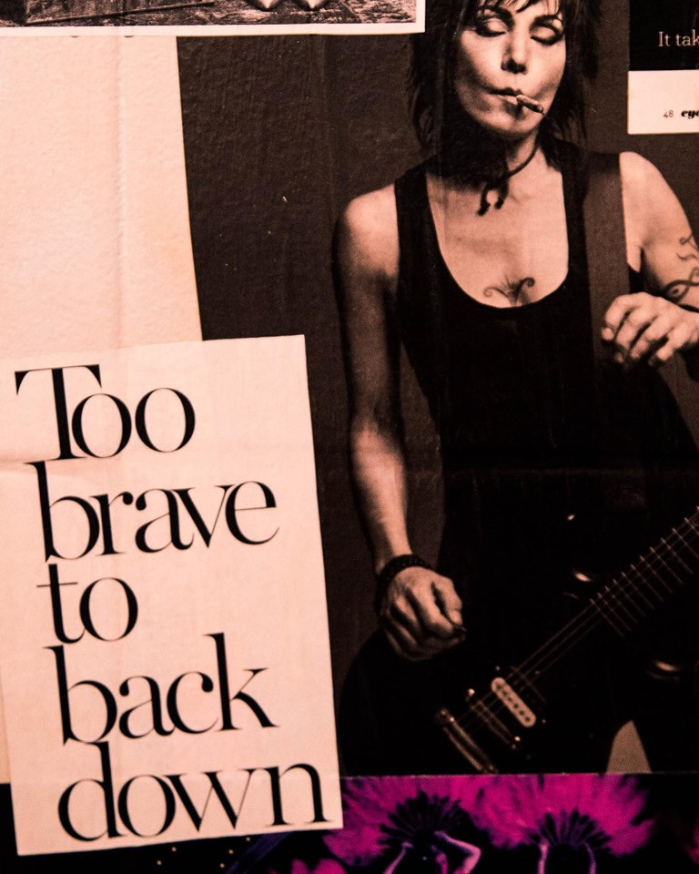 """Photo of a part of the La Mi Collage that has the words """"Too brave to back down"""" as well as the image of Pat Benetar"""