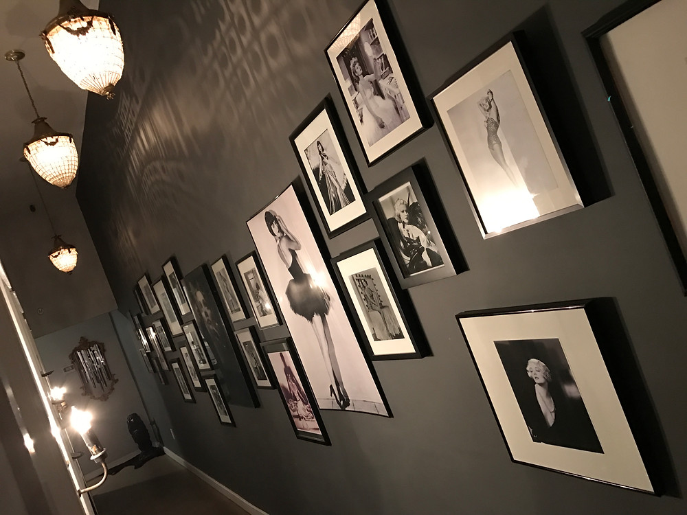 The Hallway at La Mistinguette Studios which is lined with back and white photography from the early 1900's until the 60s