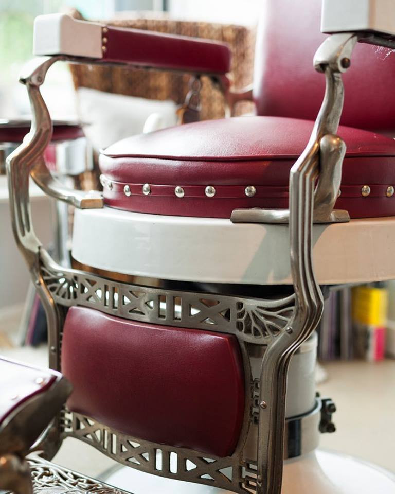 Vintage barber chair with burgundy red upolstry in Kat Kass's studio.