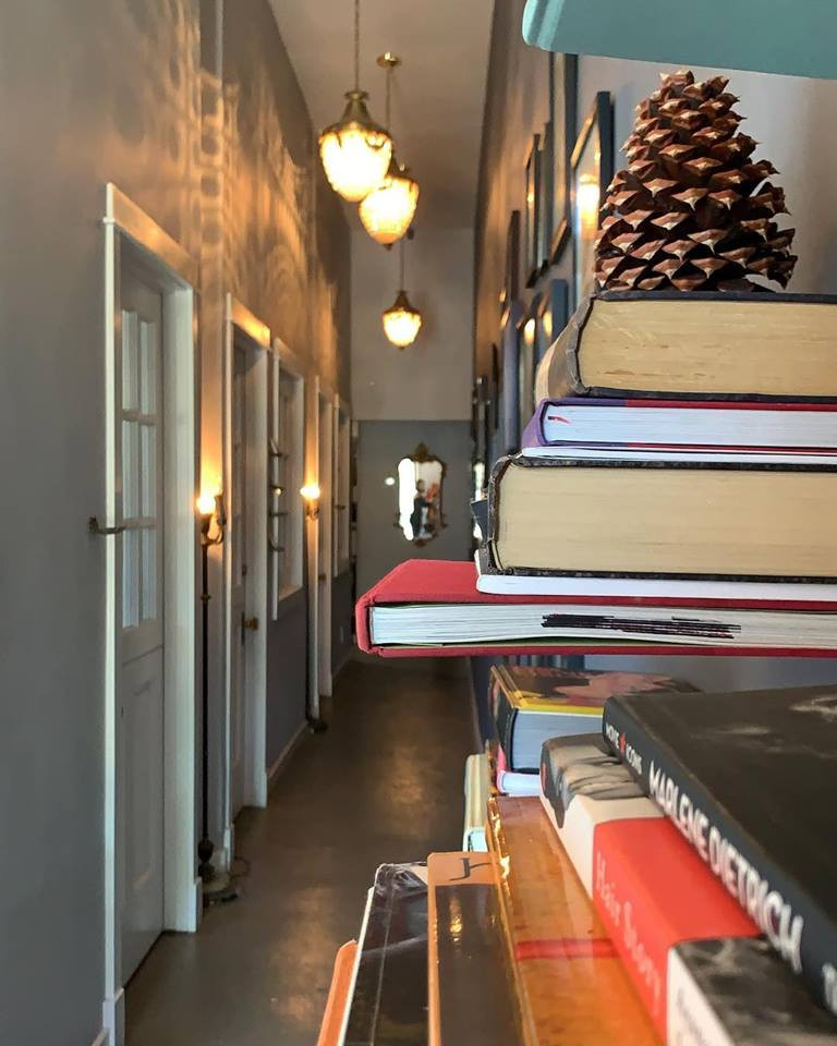 The library at La Mistinguette with a pine cone for holiday decor