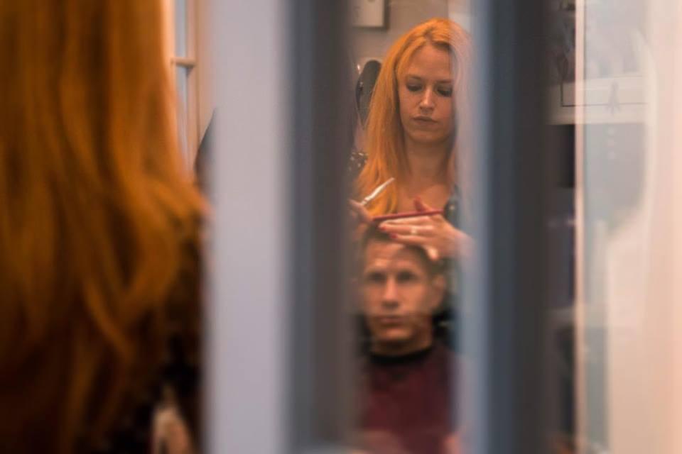 Emily Hafele of Studio Orange performing a mens hair-cut.