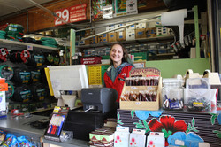 Dana smiling at the register