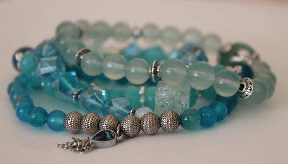 4 Layered Teal Stretch Bracelets