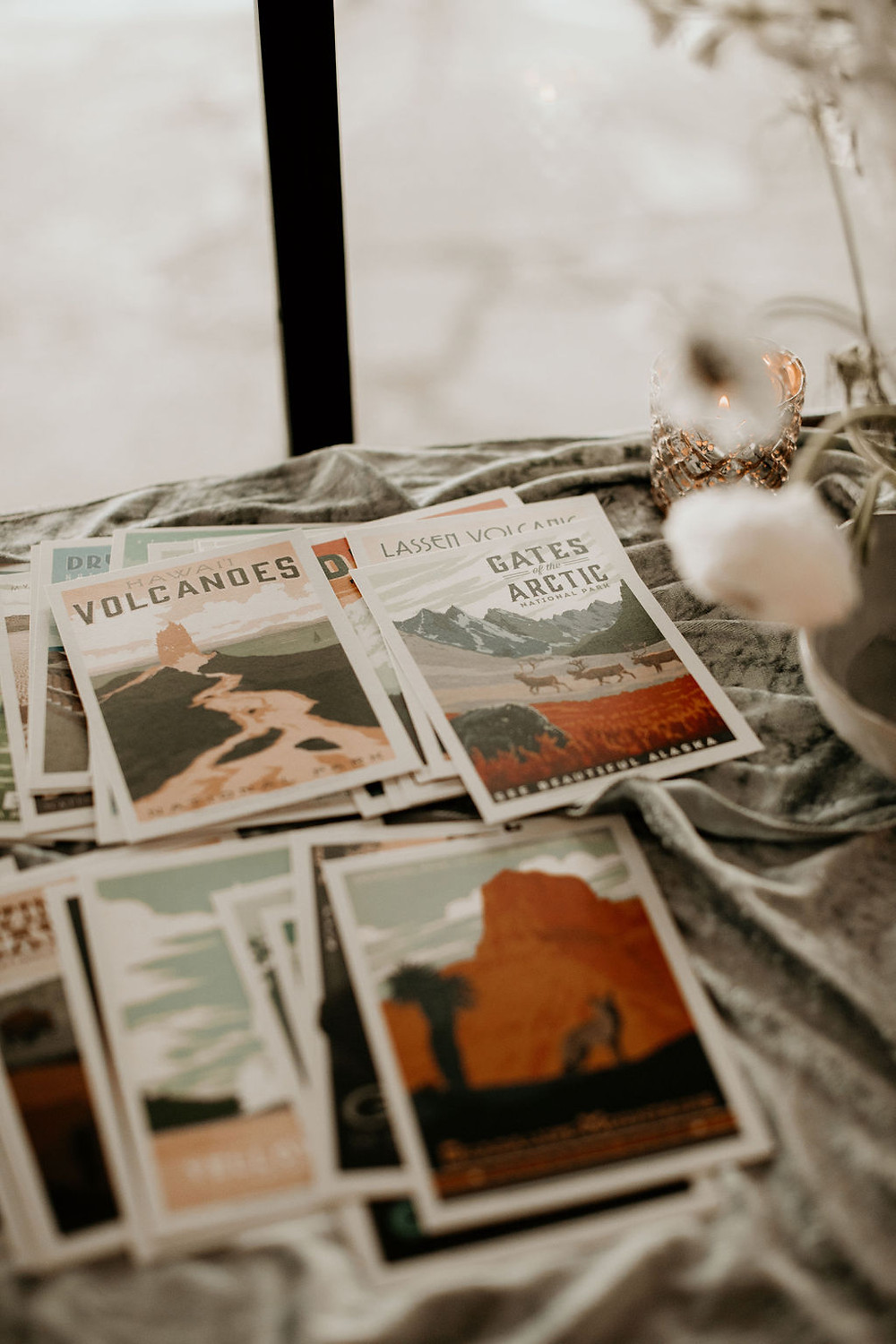 Vintage style post cards on a welcome table at a wedding.