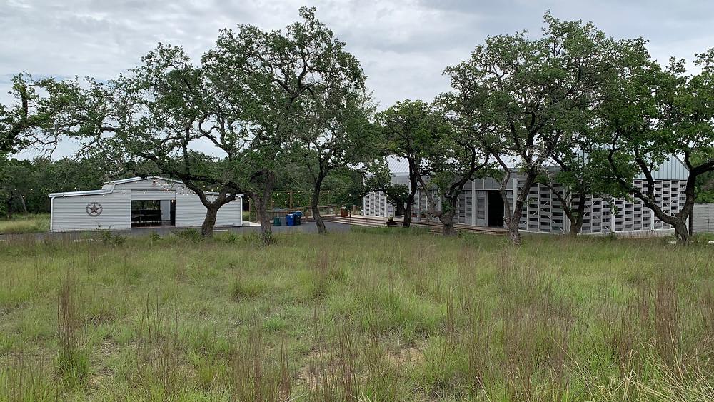 Wide shot of The Cedars Ranch venue in Wimberley, TX.