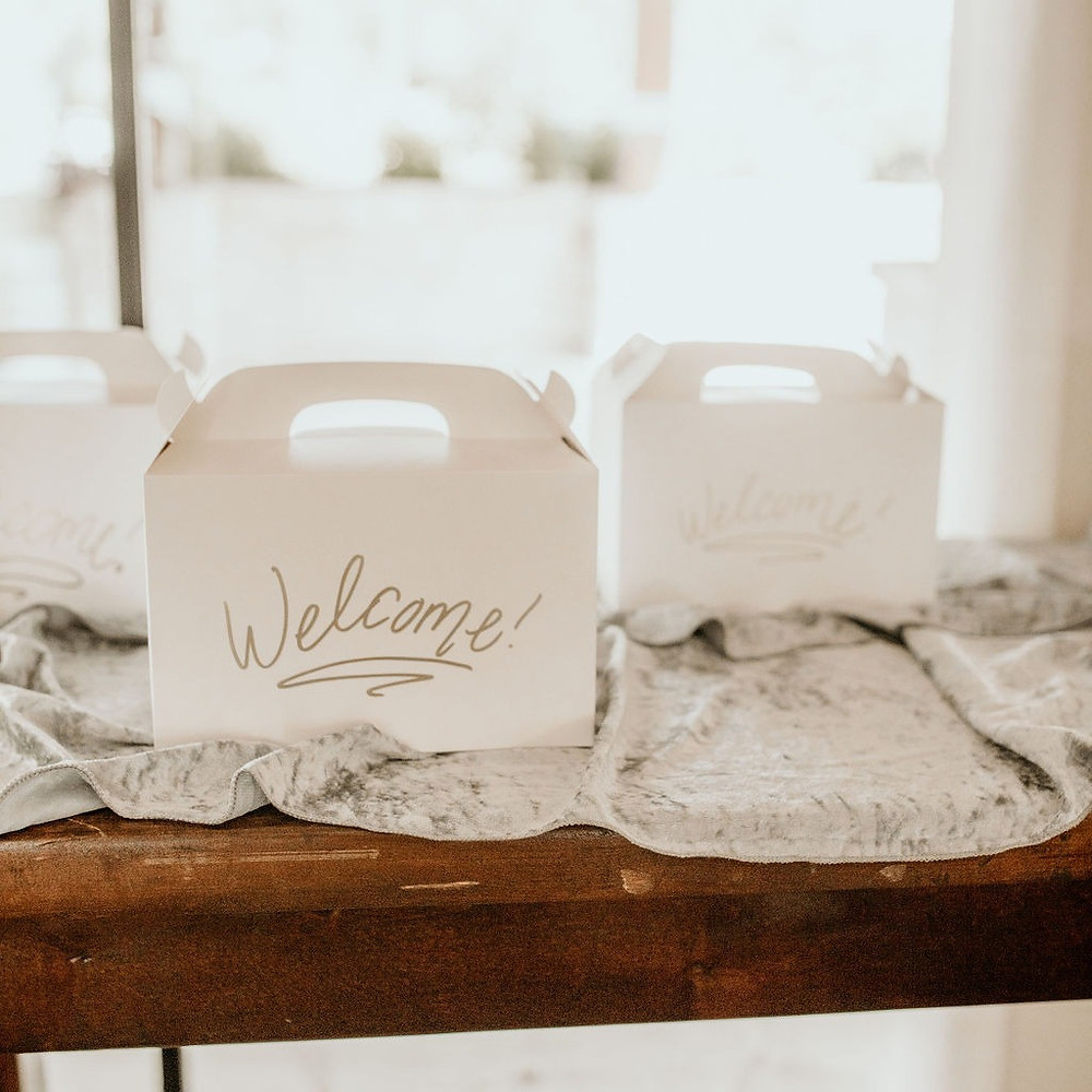 wedding welcome bags/welcome boxes for guests displayed at wedding.