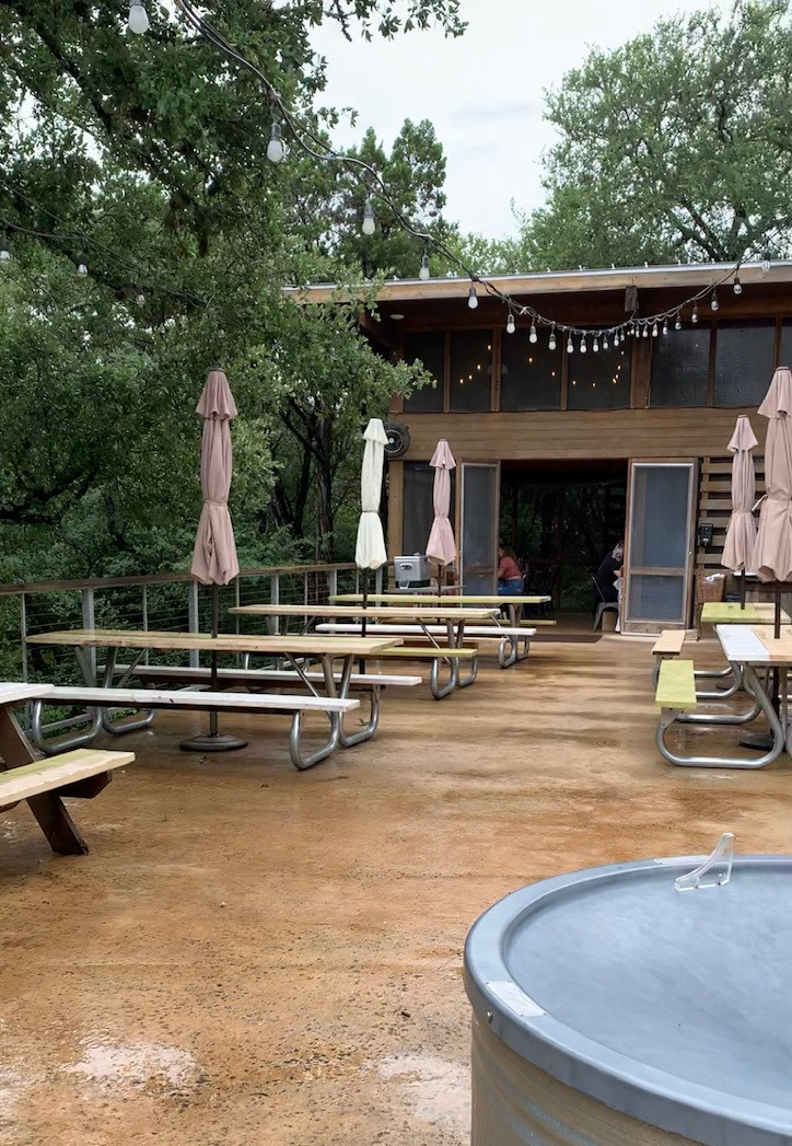 Outdoor patio at The Leaning Pear Restaurant in Wimberley, Texas