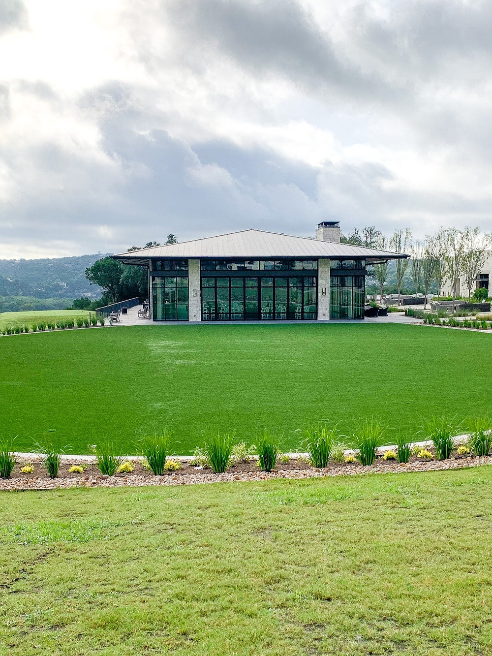 Glass walled indoor event venue overlooking the Texas hill country at the Omni Barton Creek Resort and Spa in West Austin.