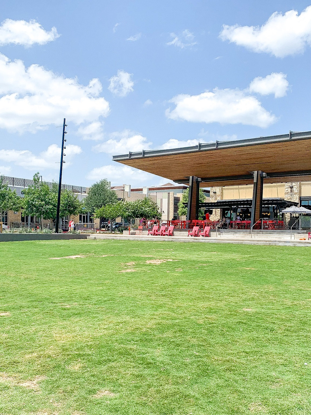 Hill Country Galleria's main event lawn with patio style seating and covered pavilion.