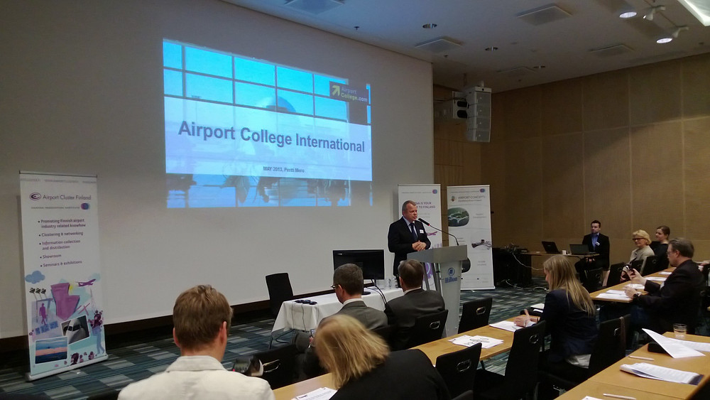 Pertti Mero talking at Helsinki Airport seminar.