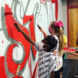 Southeast Elementary students assist with painting new mural with Malcolm McCrae