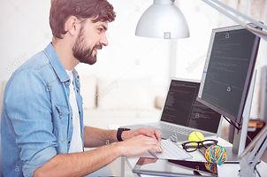 man-programming-on-his-computer-G2CF5X[1