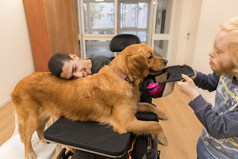 two teens having dog therapy