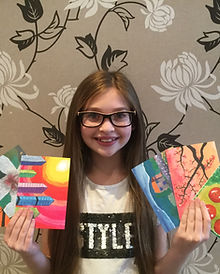 Ella Goldstein with her cards .JPG