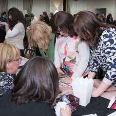 women buying tickets at the event.JPG