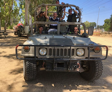 Rabbi Hammer in a jeep with soldiers