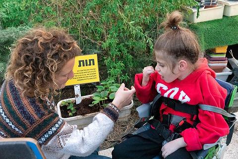 girl enjoying the Keren Or therapeutic Gardening