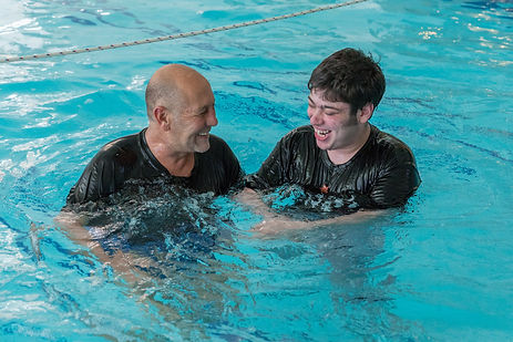 Boy and therapist in the hydrotherapy pool