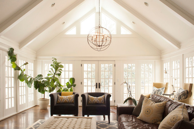vaulted cathedral ceiling painted beams round chandelier white