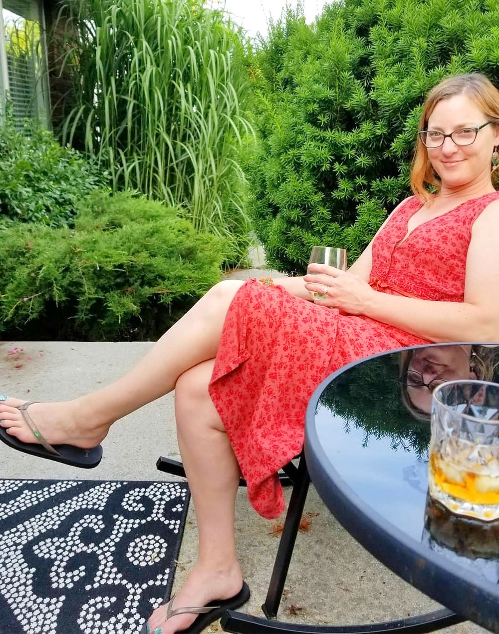 woman on porch wine glass patio life relaxing