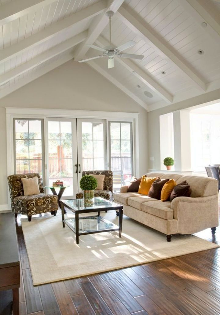 living room vaulted cathedral ceiling painted beams and tongue and groove boards