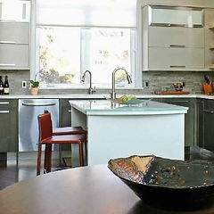modern kitchen with glass countertop island and italian leather barstools