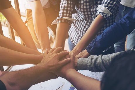 Business people join hand together durin