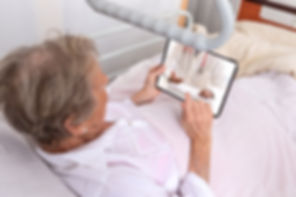 Sick senior woman with tablet pc Stay in