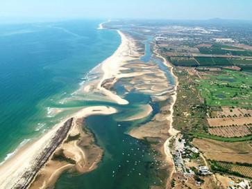Discover the breathtaking island beaches of Algarve Portugal