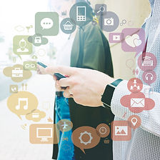 various-applications-forming-circle-front-two-people-using-mobile-phone.jpg