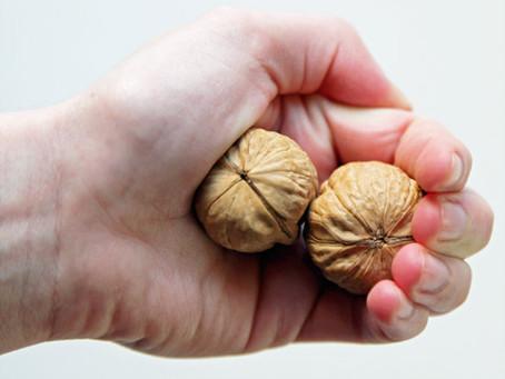 Two Children Peel Walnuts