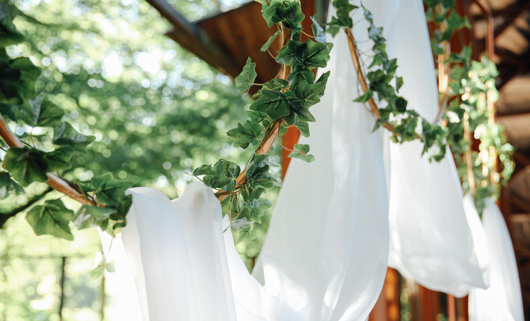 White Drapes through Ivy Hoops