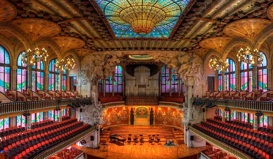 Colorful concert hall with stainglass ceiling in Barcelona, Spain