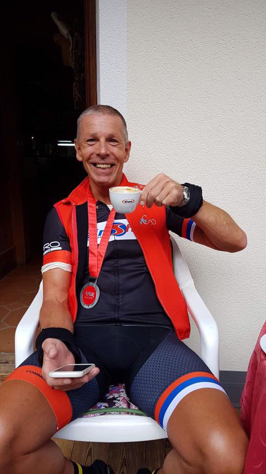 Jamie Beale having deserved cup of coffee after completing the Maratona dles Dolomites