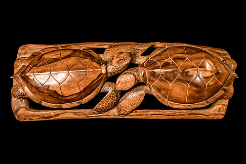 wood carving of two turtles