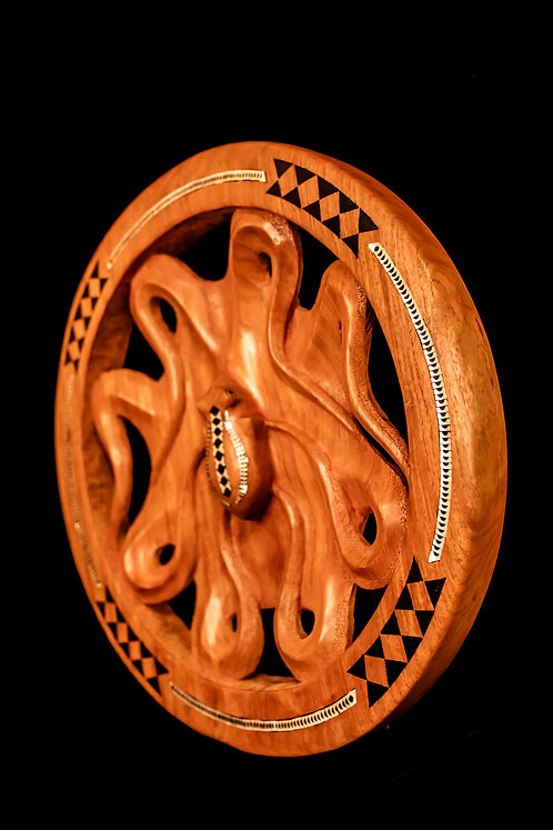 OCTOPUS CARVED IN A ROUND FRAME  Hand-carved wood
