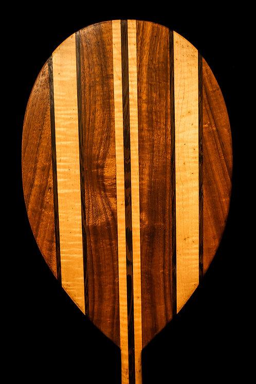 Face of laminated koa wood canoe paddle