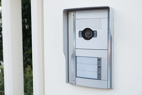 white intercom with a camera on the door