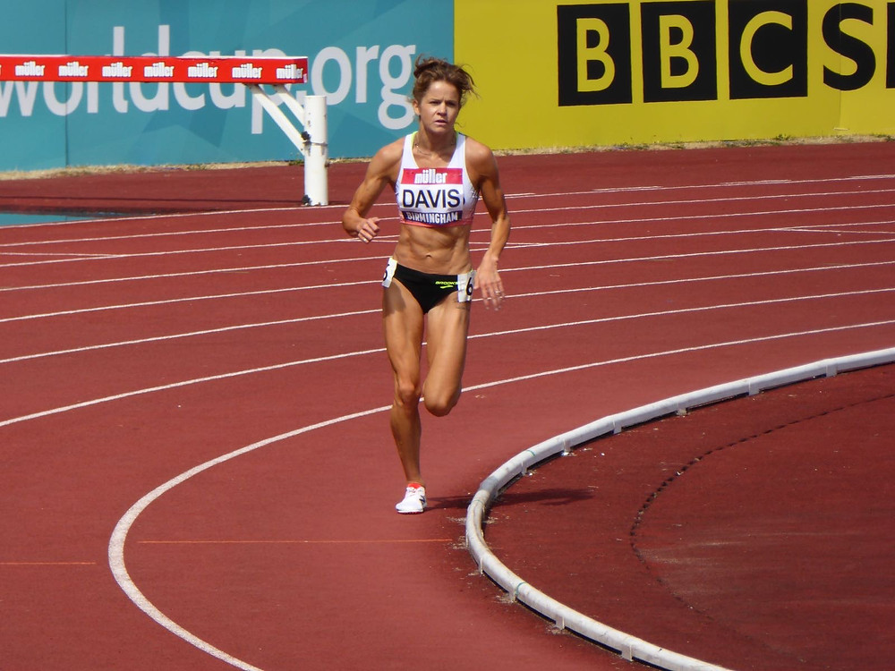 Eleanor Davis, NHS doctor and elite runner competing on track.
