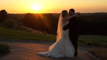 Ashe productions sunset shot of Bride & Groom