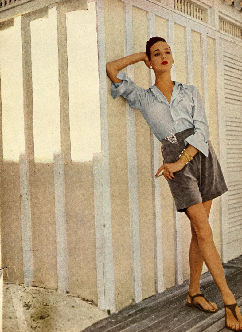 Advertisement for dress short featuring Marie Azeez El-Khoury jewels. Harper's Bazaar, Vol. 79 Iss. 2802, June 1945.
