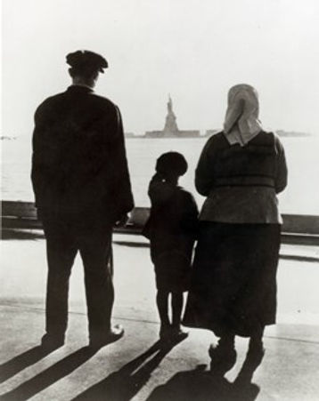 Immigrant family at Ellis Island view of the Statue of Liberty
