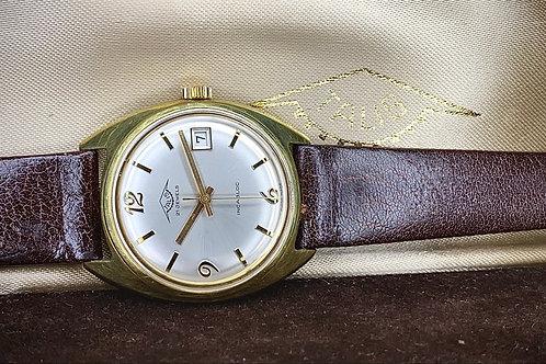 1970s Talis gold plated dress watch, NOS with box, high grade ETA 2408 movement