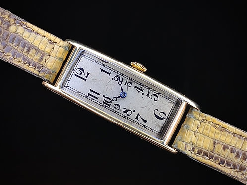 1920s Art Deco 18ct gold rectangular Banana watch with Movado movement serviced