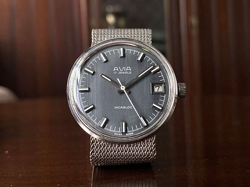 1970s Avia Dress Watch with dark Grey grained dial, integrated strap, FHF 96-4